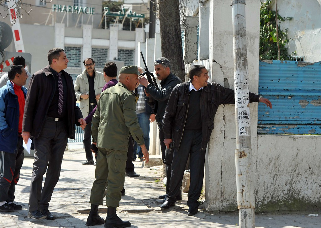 . Armed Tunisian policemen in plainclothes secure the area after gunmen attacked Tunis\' famed Bardo Museum on March 18, 2015. At least seven foreigners and a Tunisian were killed in an attack by two men armed with assault rifles on the museum, the interior ministry said. AFP PHOTO / FETHI  BELAID/AFP/Getty Images
