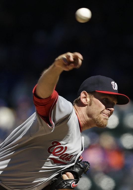 . Washington Nationals starting pitcher Stephen Strasburg throws during the third inning of the baseball game against the New York Mets on opening day at Citi Field in New York, Monday, March 31, 2014.  (AP Photo/Seth Wenig)
