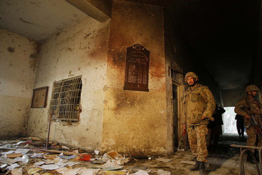 . Pakistani soldiers inspect inside the Army Public School attacked the day before by Taliban gunmen, in Peshawar, Pakistan, Wednesday, Dec. 17, 2014. Pakistan mourned as the nation prepares for mass funerals Wednesday for over 140 people, most of them children, killed in the Taliban massacre in a military-run school in the countryís northwest in the deadliest and most horrific attacks in years, officials said. (AP Photo/Mohammad Sajjad)