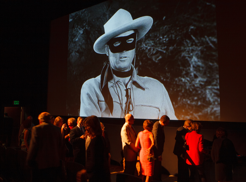 . Each of the three theaters in the Denver Film Center/Colfax had different theme for the food and entertainment. In this one, clips from  vintage Westerns played as guests grazed on barbecue, cornbread and beans. Photo by Steve Peterson, Special to The Denver Post