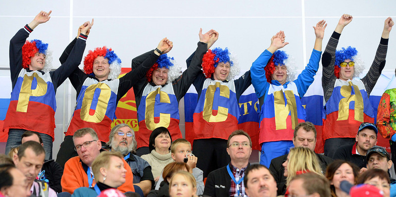 . Russian fans attend the Men\'s Speed Skating 1000 m at the Adler Arena during the Sochi Winter Olympics on February 12, 2014. (ANDREJ ISAKOVIC/AFP/Getty Images)