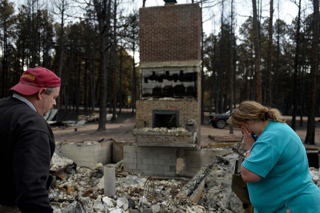 . Ted and Teresa Robertson\' look over their home that was totally taken by the fire as some residents were allowed back to see their homes in the Black Forest Fire area near Colorado Springs, Colorado. June 18, 2013.  (Photo By Joe Amon/The Denver Post)