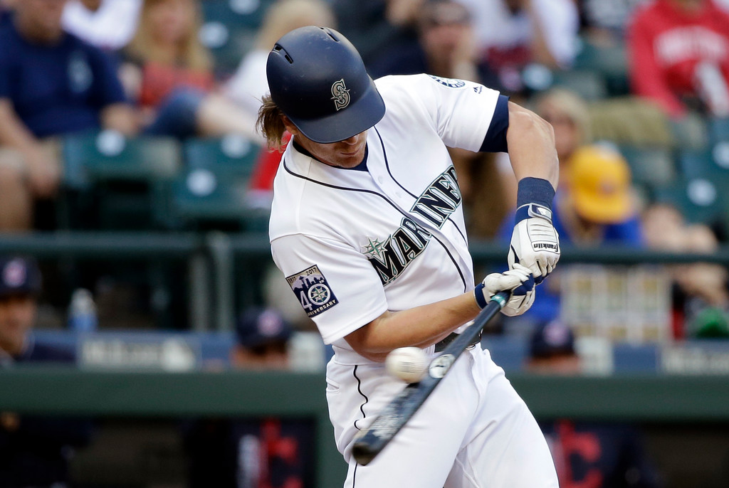 . Seattle Mariners\' Gordon Beckham narrowly misses while striking out against the Cleveland Indians in the eighth inning of a baseball game Saturday, Sept. 23, 2017, in Seattle. (AP Photo/Elaine Thompson)
