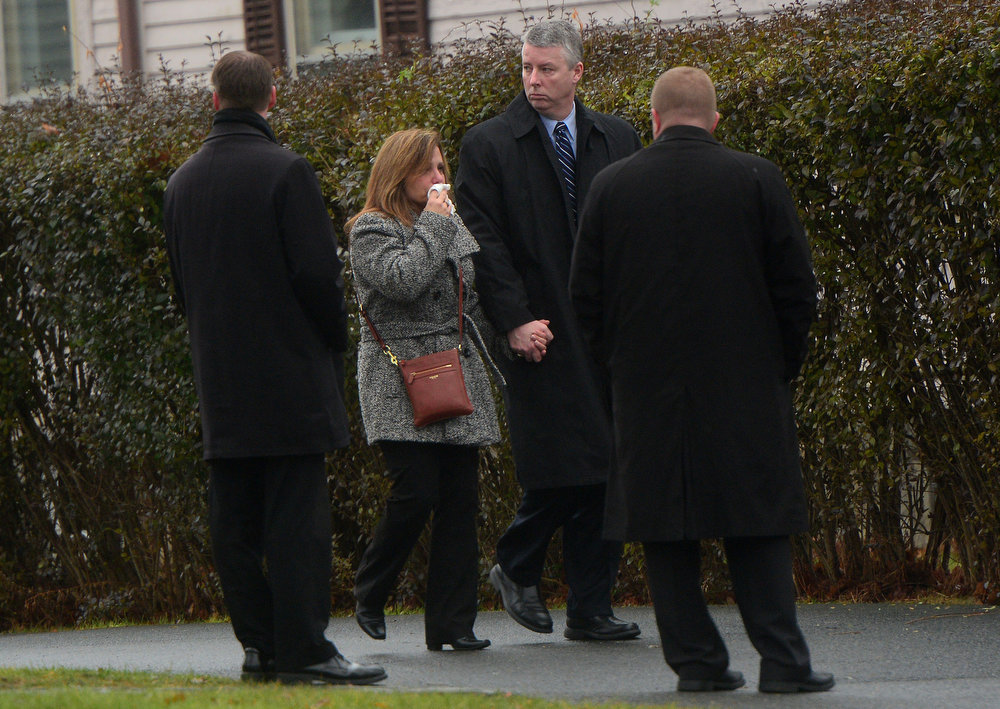 . Mourners arrive at Honan funeral home to attend the funeral for Jack Pinto, 6, one of the victims of the Sandy Hook elementary school shooting, on December 17, 2012 in Newtown, Connecticut. Funerals began in the little Connecticut town of Newtown after the school massacre that took the lives of 20 small children and six staff, triggering new momentum for a change to America\'s gun culture.    AFP PHOTO/Emmanuel DUNAND/AFP/Getty Images
