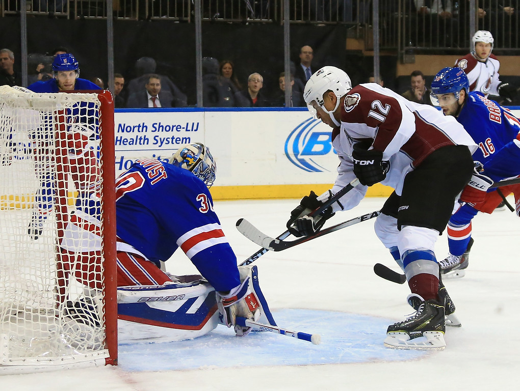 . NEW YORK, NY - NOVEMBER 13: Henrik Lundqvist #30 of the New York Rangers makes the first period save on Jarome Iginla #12 of the Colorado Avalanche at Madison Square Garden on November 13, 2014 in New York City.  (Photo by Bruce Bennett/Getty Images)