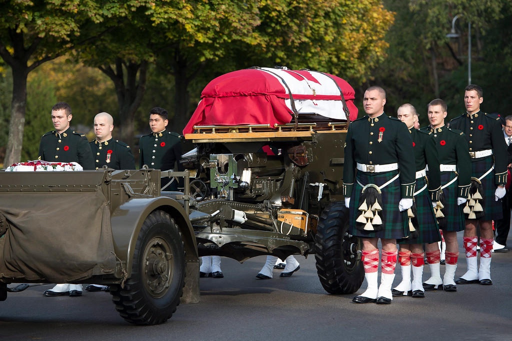 . The flag-draped casket of Cpl. Nathan Cirillo is towed during his funeral procession in Hamilton, Ontario,  on Tuesday, Oct. 28, 2014. (AP Photo/The Canadian Press, Frank Gunn)