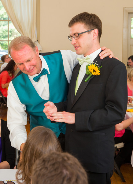 Groom and father visiting tables.jpg