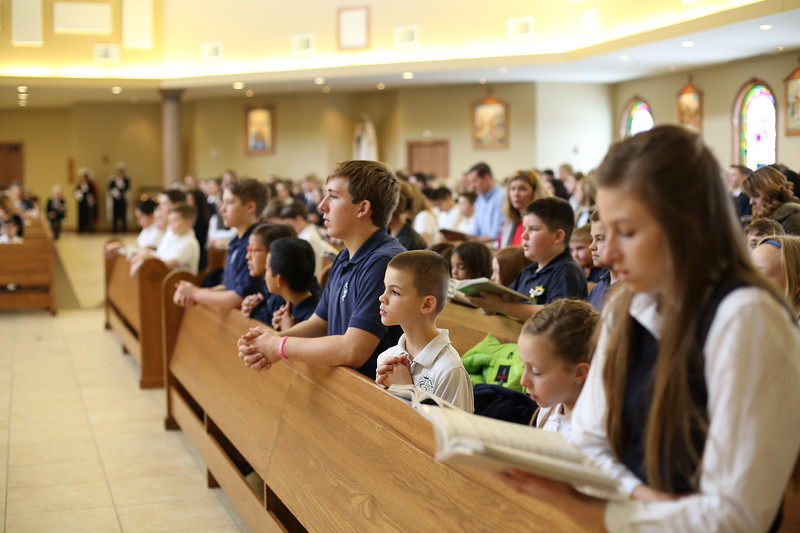 Students from TMP-Marian and Holy Family Elementary side-by-side at the 2016 Catholic Schools' Week Mass.