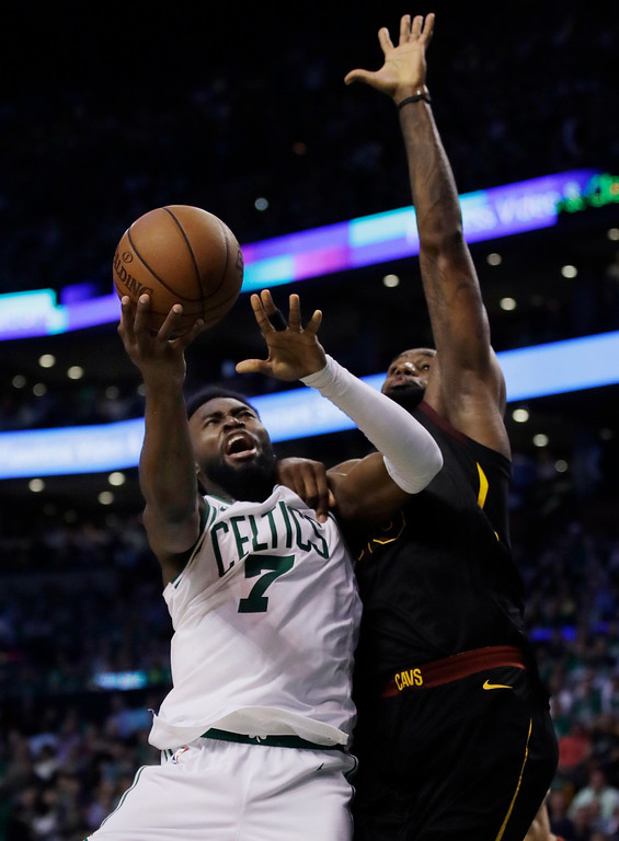 . Boston Celtics guard Jaylen Brown (7) goes to the basket against Cleveland Cavaliers forward LeBron James (23) during the third quarter of Game 5 of the NBA basketball Eastern Conference finals Wednesday, May 23, 2018, in Boston. (AP Photo/Charles Krupa)