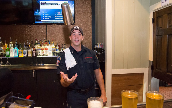 09/25/19 Wesley Bunnell | StaffrrTip a Firefighter took pace at Chili's in New Britain on Wednesday night. The event raised money for the city 's partnership with the community foundation regarding the new disaster relief program. Lt. Tim Cyr manned the bar mixing drinks for customers.