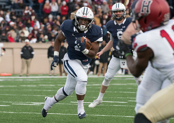 11/23/19 Wesley Bunnell | StaffrrYale rallied late in The Game against Harvard on Saturday afternoon at the Yale Bowl for a 50-43 victory in double over time. RB Alan Lamar (2) with a carry deep in Harvard territory.