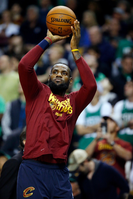 . Cleveland Cavaliers forward LeBron James shoots the ball as he warms up before Game 1 of the NBA basketball Eastern Conference Finals against the Boston Celtics, Sunday, May 13, 2018, in Boston. (AP Photo/Michael Dwyer)