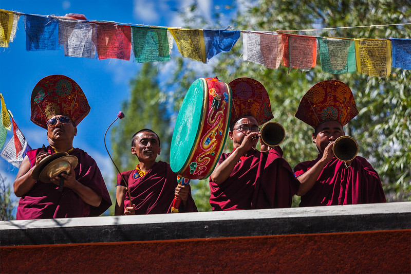 Tibetan Buddhist monks playing traditional musical instruments