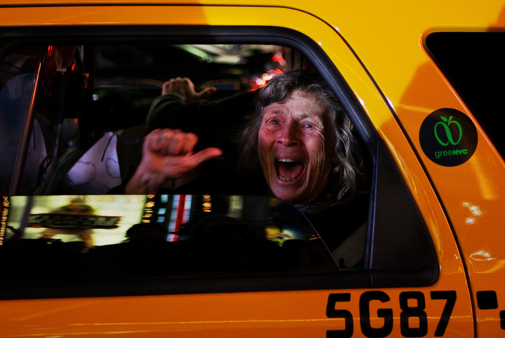 . In this Tuesday, Nov. 4, 2008 file photo made by Associated Press photographer Anja Niedringhaus, a woman reacts while sitting in a New York taxi as different television networks call the presidential race for Barack Obama, in New York.  (AP Photo/Anja Niedringhaus, File)