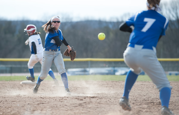 04/09/18 Wesley Bunnell | Staff Southington softball defeated Bristol Eastern 6-1 at Southington High School on Monday afternoon. Taylor Keegan (6) fields and throws Lauren Aparo (7)