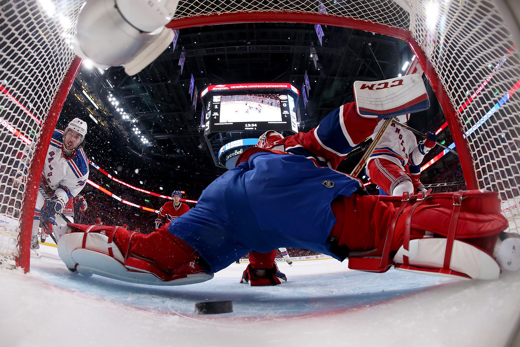 . MONTREAL, QC - MAY 17:  Mats Zuccarello #36 of the New York Rangers scores a goal in the first period past goaltender Carey Price #31 of the Montreal Canadiens in Game One of the Eastern Conference Finals of the 2014 NHL Stanley Cup Playoffs at the Bell Centre on May 17, 2014 in Montreal, Canada.  (Photo by Bruce Bennett/Getty Images) *** BESTPIX ***