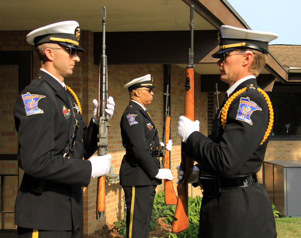 . An honor guard at St. Stephen\'s Lutheran Church in West St. Paul stands at attention during the funeral for  Mendota Heights police officer Scott Patrick on Wednesday.  (Minnesota Department of Public Safety Pool Photo: Jen Longaecker)