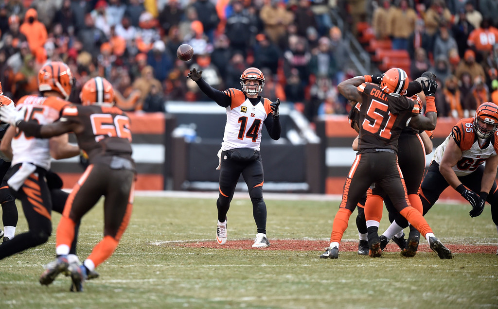 . Cincinnati Bengals quarterback Andy Dalton (14) passes in the second half of an NFL football game against the Cleveland Browns, Sunday, Dec. 11, 2016, in Cleveland. (AP Photo/David Richard)