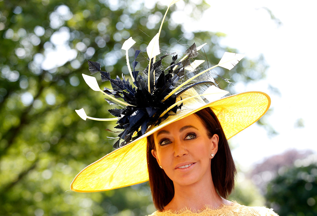 . A race goer wears an ornate hat on the first day of the Royal Ascot horse racing meeting in Ascot, England, Tuesday, June, 17, 2014. Royal Ascot is the annual five day horse race meeting attended daily by Queen Elizabeth II.  (AP Photo/Alastair Grant)