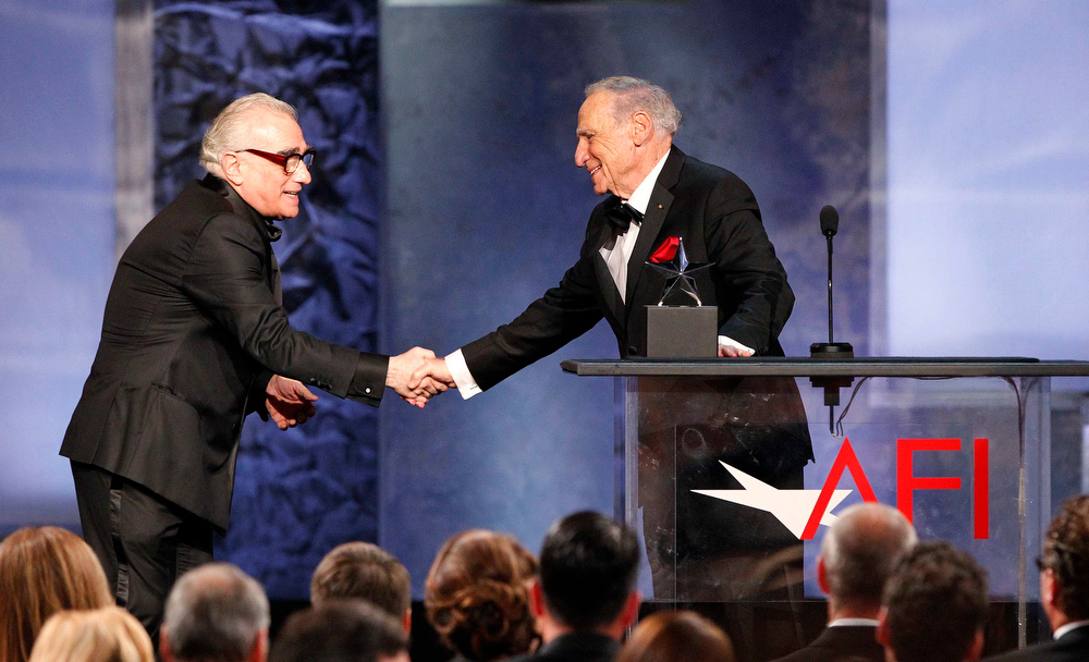 . Producer Mel Brooks (R) is congratulated by director and presenter Martin Scorsese after accepting the American Film Institute\'s 41st Life Achievement Award at the Dolby theatre in Hollywood, California June 6, 2013. REUTERS/Mario Anzuoni