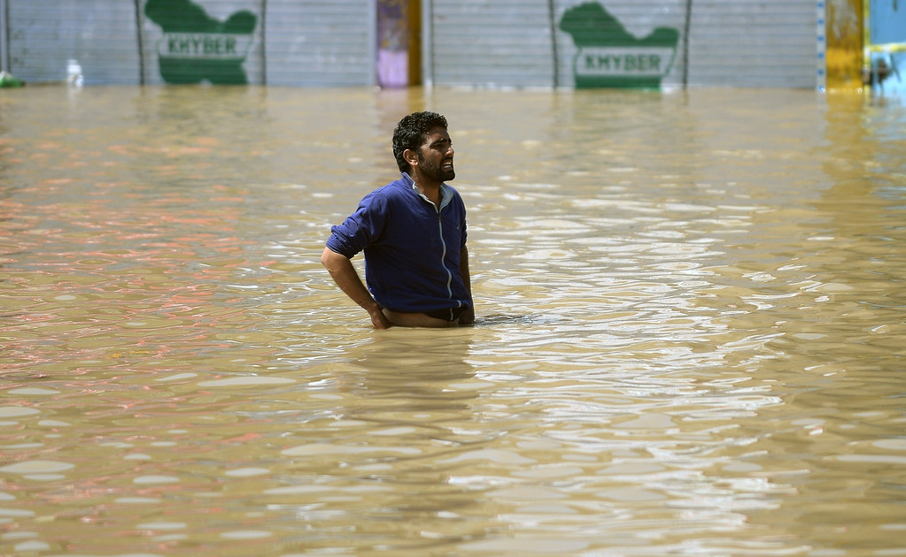 . A Kashmiri man stands in the floodwaters in Srinagar on September 10, 2014.    AFP PHOTO/ PUNIT PARANJPE/AFP/Getty Images