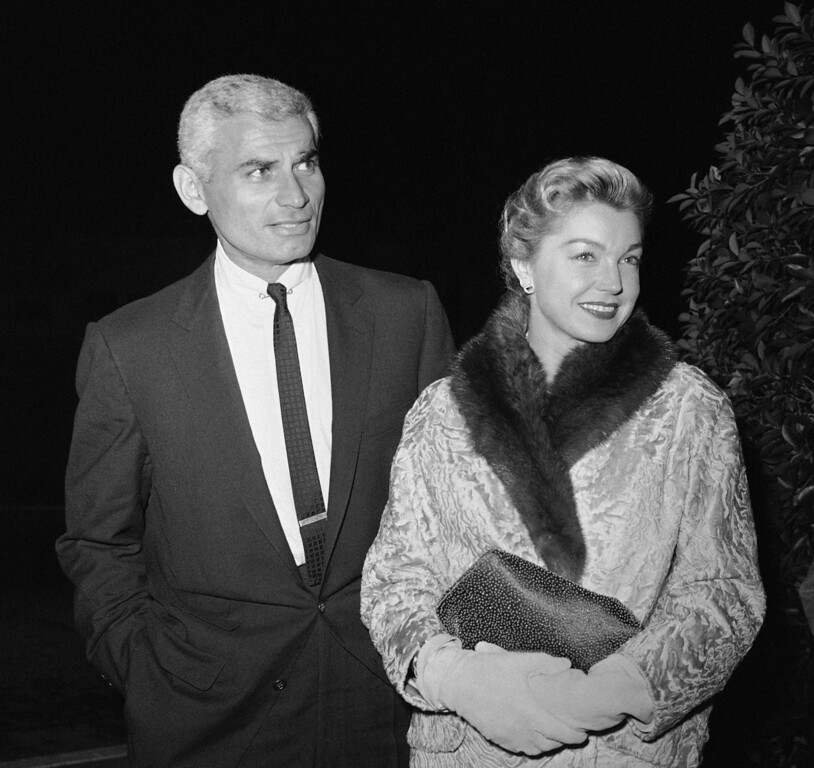". Jeff Chandler and Esther Williams, a steady pair in Hollywood, arrive for the invitational press preview of ""The Perfect Furlough\"" at the Academy Awards Theater in Hollywood, Nov. 11, 1958. (AP Photo/Harold P. Matosian)"