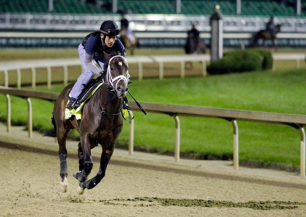 . Exercise rider Joel Barrientos takes Kentucky Derby entrant Vicar\'s in Trouble for a morning workout at Churchill Downs Thursday, May 1, 2014, in Louisville, Ky. (AP Photo/Morry Gash)