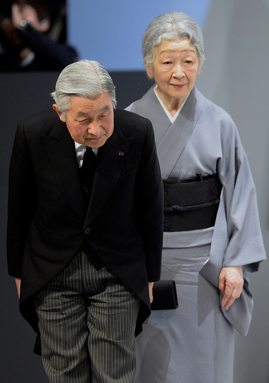 . Japanese Emperor Akihito, left,  and Empress Michiko bow to the audience as they leave the national memorial service for the victims of the March 11, 2011 earthquake and tsunami in Tokyo, Japan, March 11, 2014. Japan marked the third anniversary of a devastating earthquake and tsunami that left nearly 19,000 people dead or missing, turned coastal communities into wasteland and triggered a nuclear crisis. (AP Photo/Franck Robichon, Pool)