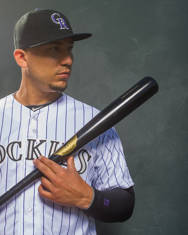 . 5 Carlos Gonzalez Position: LF Height: 6-1 Weight: 220 Bats/throws: Left/left Expectations: One of baseball�s premier left fielders, CarGo was an all-star again last year. But a sprained right middle finger limited him to 19 games and just 41 at-bats after the all-star break. Expect CarGo to hit above .300. If he drives in around 100 runs, that means the Rockies� offense is humming.   2014 salary: $10.5 million  (Photo by Rob Tringali/Getty Images)