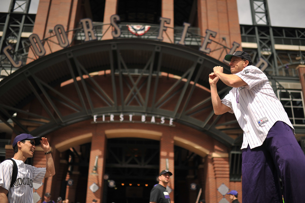 """. Gary Carnes, \""""Shorty\"""", wears stilts and interacts with fans before the gates open to Coors Field. The Colorado Rockies took on the San Diego Padres on Opening Day at Coors Field in Denver, Colorado. (Photo by Hyoung Chang/The Denver Post)"""