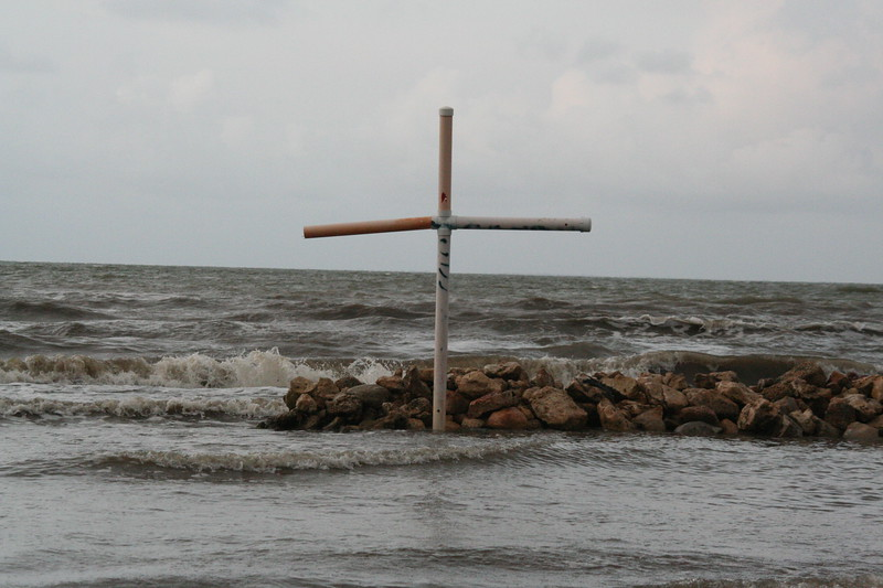 A cross watches over Lívingston's shores