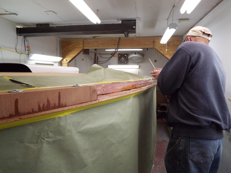 Appling epoxy to the boats so the cover boards can be glued in place.