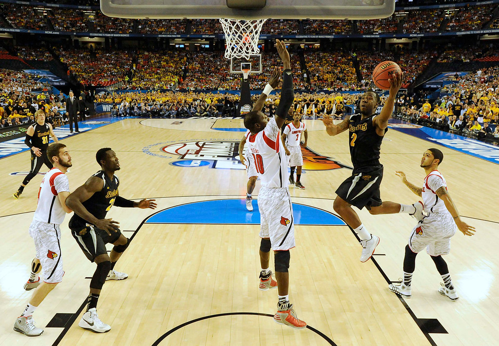 . Wichita State Shockers guard Malcolm Armstead (2) goes to the basket against the Louisville Cardinals in the first half of their NCAA men\'s Final Four basketball game in Atlanta, Georgia April 6, 2013.  Reuters/Chris Steppig -Pooll