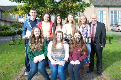 St Josephs High School Crossmaglen pupils are pictured with Principal John Jones after receiving their GCSE results. R1435001