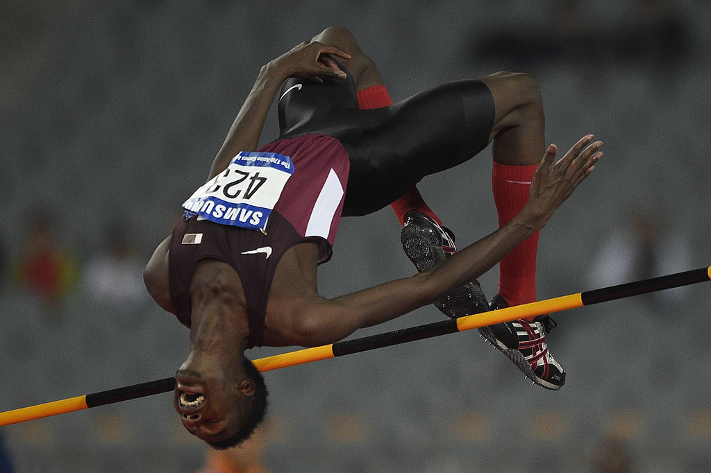 . Qatar\'s Muamer Aissa Barsham competes in the final of the men\'s high jump athletics event during the 17th Asian Games at the Incheon Asiad Main Stadium in Incheon on September 29, 2014. MARTIN BUREAU/AFP/Getty Images
