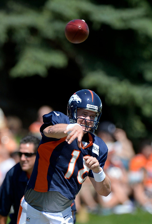 . Denver Broncos QB Peyton Manning (18) throws a pass down field during training camp August 12, 2013 at Dove Valley. (Photo By John Leyba/The Denver Post)