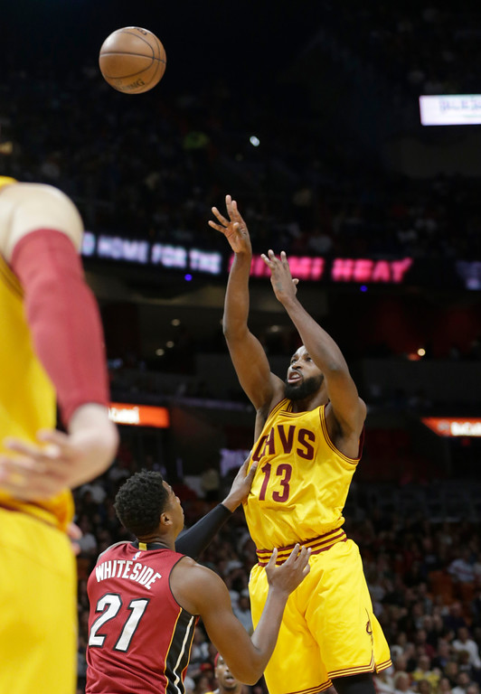 . Cleveland Cavaliers\' Tristan Thompson (13) attempts a three point basket as Miami Heat\'s Hassan Whiteside (21) defends during the first half of an NBA basketball game, Saturday, March 4, 2017, in Miami. (AP Photo/Lynne Sladky)