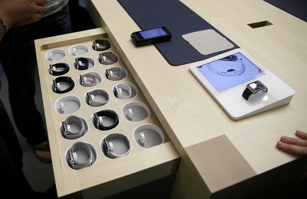 . Apple\'s new watches are displayed at a store in San Francisco, Friday, April 10, 2015. Apple has started taking orders for the watch on its website and the Apple Store app. Currently, that\'s the only way Apple is selling the watch, with shipments scheduled to start April 24. (AP Photo/Eric Risberg)
