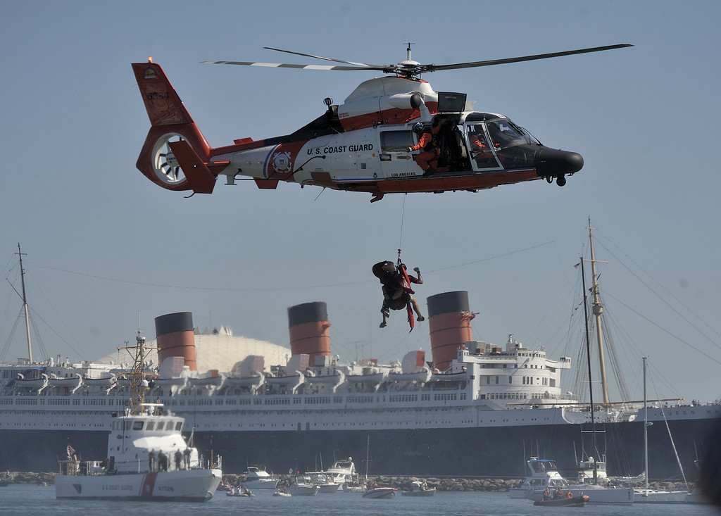 """. LONG BEACH, CALIF. USA -- The U.S. Coast Guard conducts a demonstration rescue in Rainbow Harbor after it\'s Flugtag entry \""""Team Coast Guard\"""" competed in the event in Long Beach, Calif. on August 21, 2010. Thirty five teams competed in the Red Bull event where teams build homemade, human-powered flying machines and pilot them off a 30-foot high deck in hopes of achieving flight.  Flugtag means \""""flying day\"""" in German. They are on distance, creativity and showmanship..Photo by Jeff Gritchen / Long Beach Press-Telegram.."""