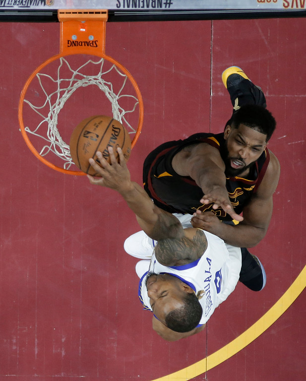 . Golden State Warriors\' Andre Iguodala dunks against Cleveland Cavaliers\' Tristan Thompson during the second half of Game 3 of basketball\'s NBA Finals, Wednesday, June 6, 2018, in Cleveland. The Warriors defeated the Cavaliers 110-102 to take a 3-0 lead in the series. (AP Photo/Carlos Osorio, Pool)