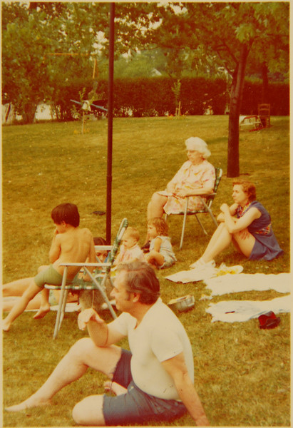 Grandma, Ma Clem, Aunt Margie, Snoosh (under the chair), and an unidentified male babysit me, Germaine, and Rebeccah at my parent's house in Island Lake, Illinois. This would be the summer of 1974, I'm guessing. Rachel is probably here too, out of frame. And someone is obviously photographing, but I don't know who.