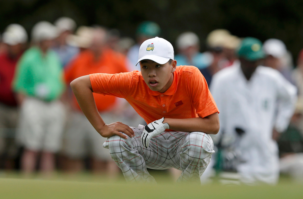 Description of . Amateur Guan Tianlang of China lines up a putt on the first green during second round play in the 2013 Masters golf tournament at the Augusta National Golf Club in Augusta, Georgia, April 12, 2013.  REUTERS/Phil Noble