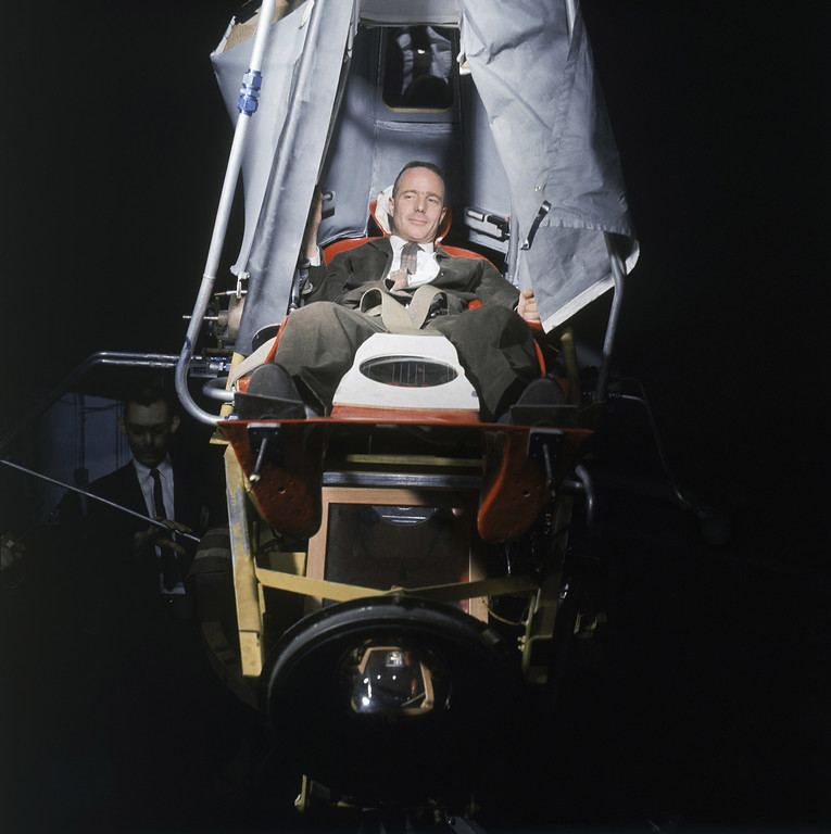 . Lt. Cmdr. Scott Carpenter, USN, one of the 7 U.S. astronauts undergoing intensive training at the National Aeronautics and Space Administration Research Center, Langley Field, Va., for possible flight into space in the Project Mercury capsule. Carpenter in reclined position in the Alfa trainer as he demonstrates one of the procedures to ready the man for space flight, Jan. 11, 1961. The trainer furnishes practice in the use of manual controls to keep the capsule in proper position during flight. Mirror in lower foreground is part of the optical system which gives the astronaut a visual check on the relationship of the capsule and the earth during simulated flight. (AP Photo)