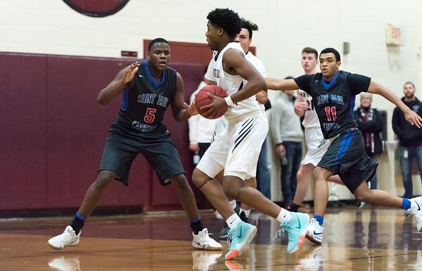12/27/18 Wesley Bunnell   Staff Newington basketball vs St. Paul on Thursday evening played at Farmington High School. Louis Egbuna (2) guarded by AJ Brooks (5).