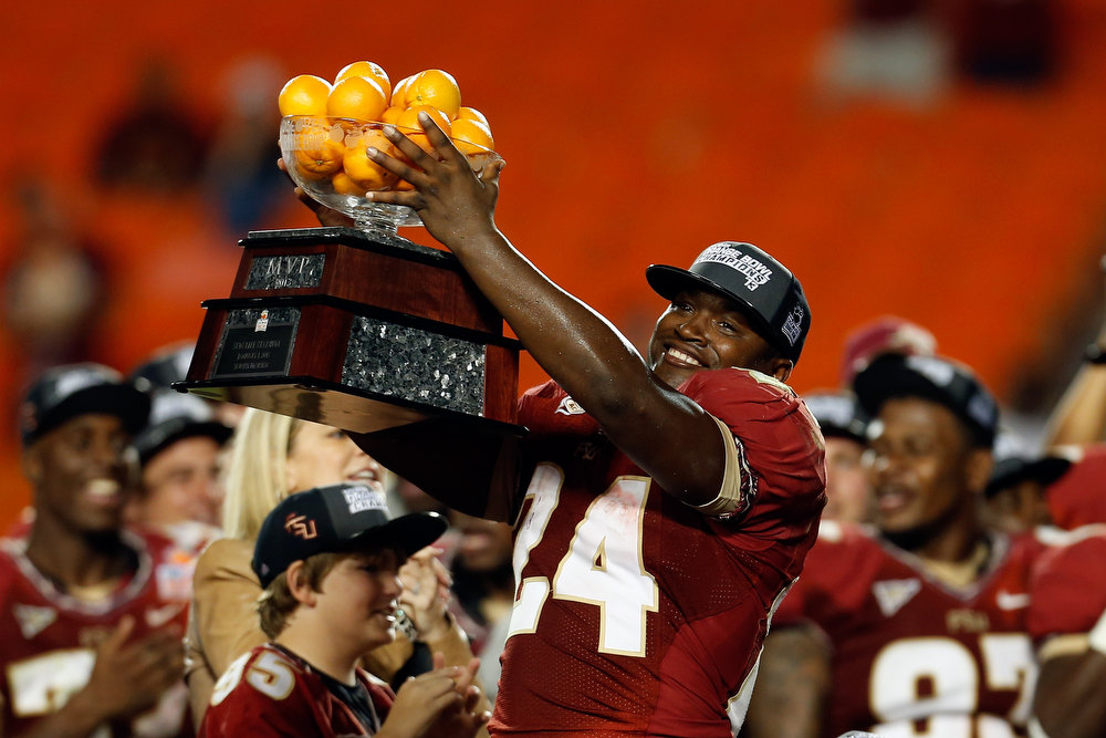 Description of . Orange Bowl MVP Lonnie Pryor #24 of the Florida State Seminoles celebrates after they won 31-10 against the Northern Illinois Huskies during the Discover Orange Bowl at Sun Life Stadium on January 1, 2013 in Miami Gardens, Florida.  (Photo by Chris Trotman/Getty Images)