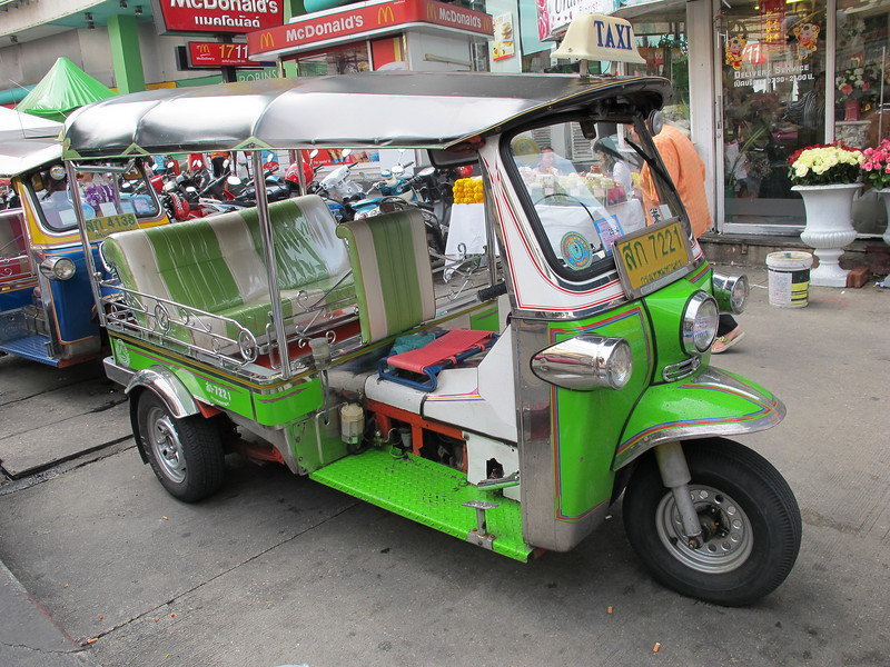 A spiffy Tuk-Tuk (an auto rickshaw), the common man's inexpensive taxi in Bangkok.  Each rides comes with a surgical face mask (included) to protect against inhalation of particulates which abound.