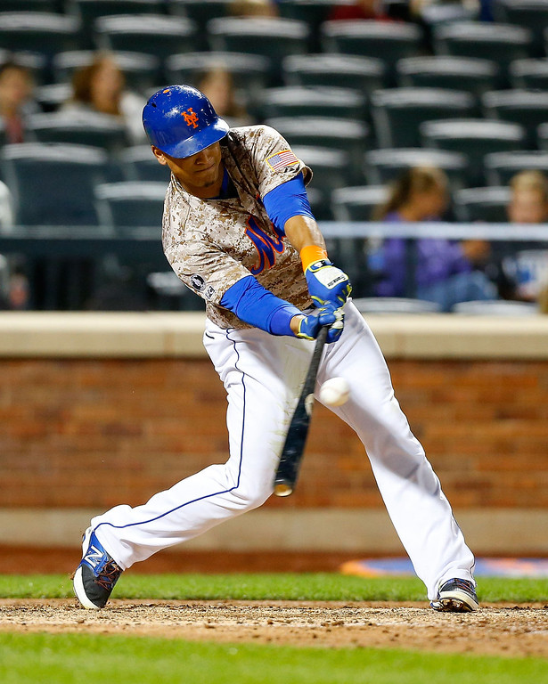 . Juan Lagares #12 of the New York Mets connects on a fifth inning double against the Colorado Rockies at Citi Field on September 8, 2014 in the Flushing neighborhood of the Queens borough of New York City.  (Photo by Jim McIsaac/Getty Images)