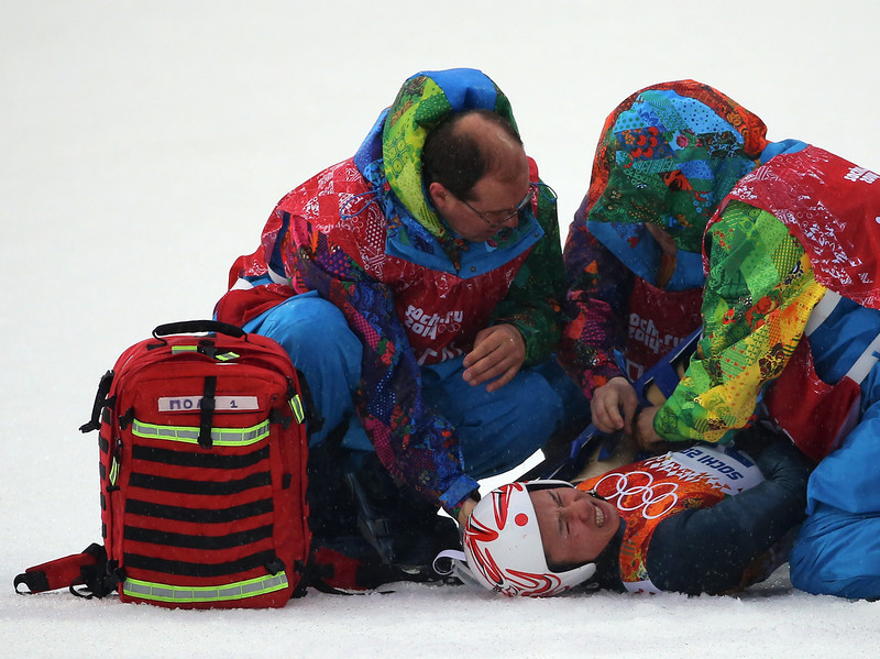 . Taihei Kato of Japan is treated by medical staff after crashing during the Nordic Combined Men\'s Individual LH on day 10 of the Sochi 2014 Winter Olympics at RusSki Gorki Jumping Center on February 18, 2014 in Sochi, Russia.  (Photo by Robert Cianflone/Getty Images)