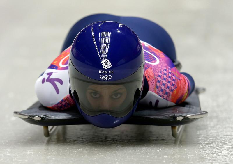 . Shelley Rudman of Great Britain starts her third run during the women\'s skeleton competition at the 2014 Winter Olympics, Friday, Feb. 14, 2014, in Krasnaya Polyana, Russia. (AP Photo/Natacha Pisarenko)