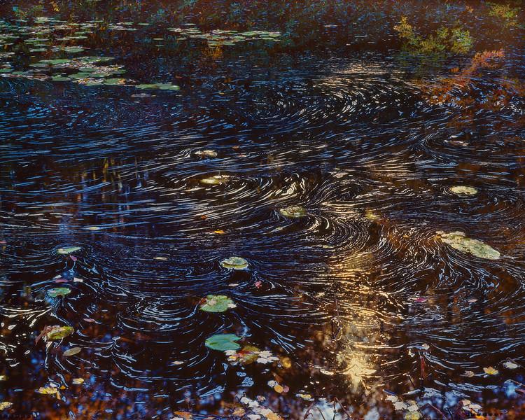 Swirls with Sun on Black Water